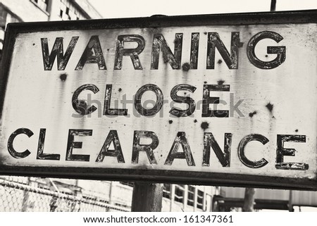 Sign at an Abandoned Automotive Factory - Rusted Sign at an Abandoned Automotive Factory - stock photo