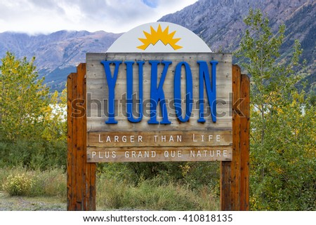 Sign at the border of Yukon and British Columbia, Canada. Shallow depth of field.