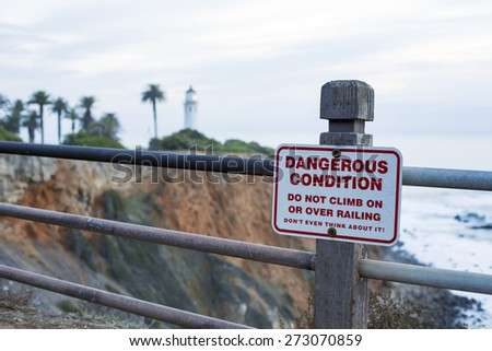 sign at the coast to warn for dangerous cliffs - stock photo