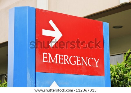 sign at the hospital points towards the emergency room entrance. - stock photo