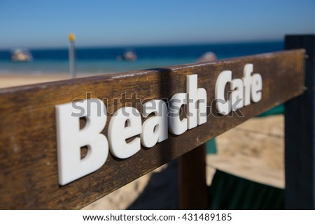 Sign Board at a sand beach - stock photo