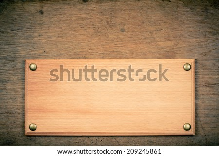 Sign board blank on old vintage wooden wall background - stock photo