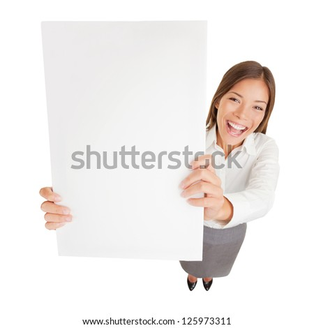 Sign board woman. Businesswoman with blank sign excited. Fun high angle young happy cheerful businesswoman holding up a blank sign for with copyspace for your advert or text isolated on white - stock photo