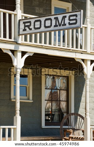 Sign for available rooms in the old western hotel - stock photo
