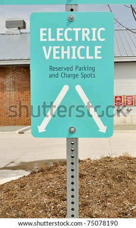 Sign for designated parking spot and charge point for electric vehicle - stock photo
