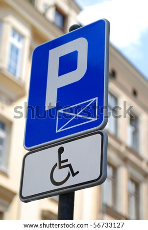 Sign for disabled parking spot that is only allowed with a special handicapped id - stock photo