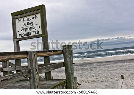 Sign for no Lifeguards on duty and swimming prohibited during winter on beach on Long Island, New York - stock photo