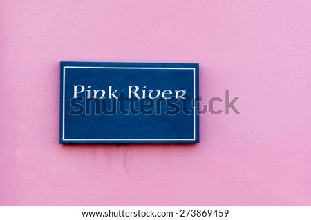 Sign for 'Pink River' engraved on a tile mounted on a wall - stock photo