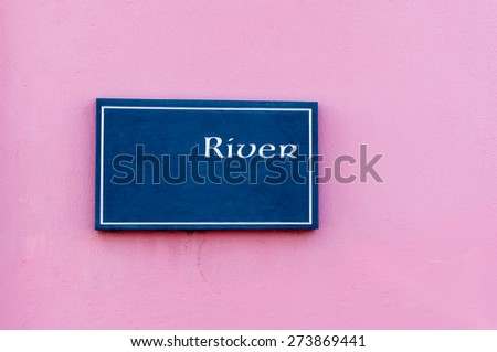 Sign for 'River' engraved on a tile mounted on a wall - stock photo