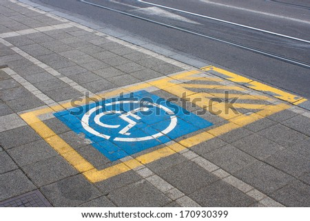 Sign for the bus stop for disabled people - stock photo