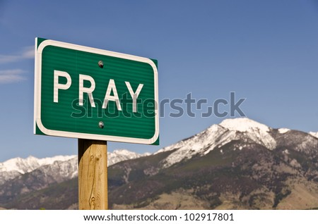 Sign for the town of Pray, Montana.  Use it for religious or spiritual themes. - stock photo