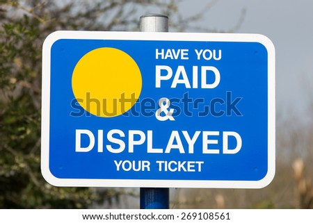 Sign for visitors at a car park. Have you paid & displayed your ticket sign.  Photo taken on April 07, 2015 - stock photo