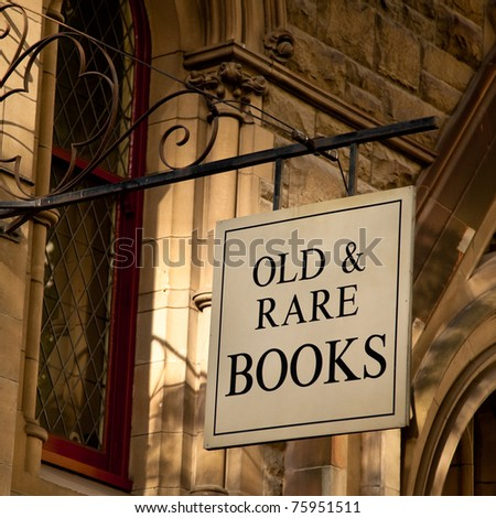 "Sign hanging outside an old building, reads ""Old & Rare Books""; Melbourne, Australia. - stock photo"
