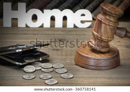 Sign Home, Judges Or Auctioneer Gavel, Empty Purse And Old Law Book On The Wood Table. Concept For Trial, Bankruptcy, Tax, Mortgage,  Auction Bidding, Foreclosure Or Inherit Real Estate - stock photo