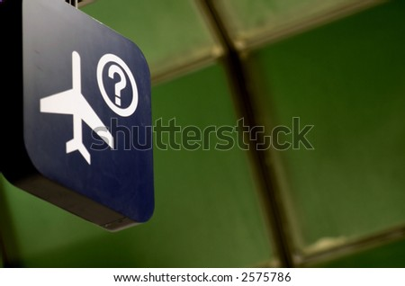 Sign in airport terminal showing flight information - stock photo