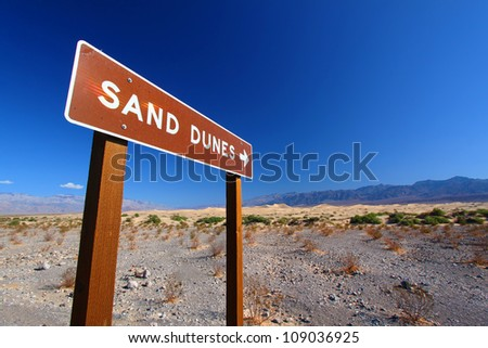 Sign in Death Valley National Park pointing out location of the Mesquite Flat Sand Dunes for visitors