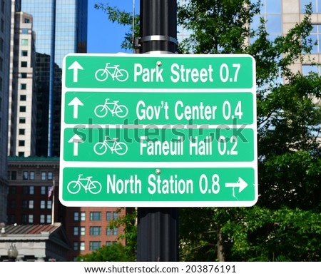 Sign in downtown Boston directing bicyclists to local landmarks. - stock photo