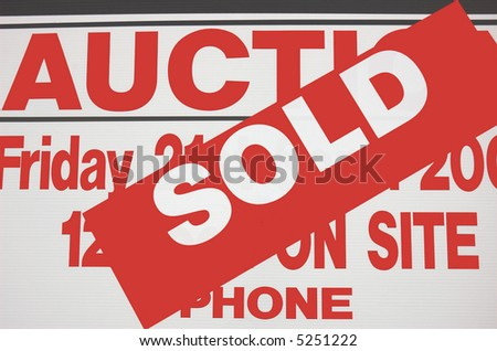 Sign indicates Home successfully sold at auction.
