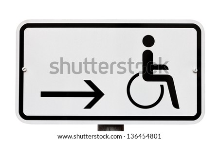 Sign indicating provision for disabled to the left