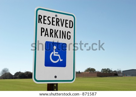 Sign indicating reserved parking - stock photo
