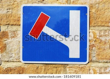 Sign indicating the road to the left is a dead end. - stock photo