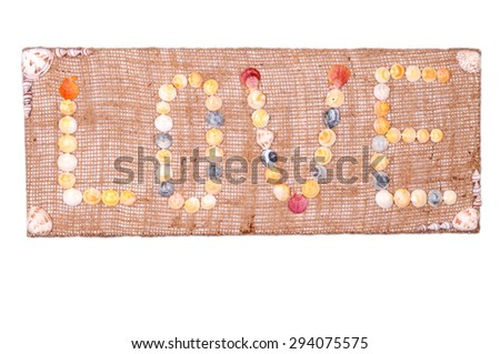 Sign Love isolated on white background. Art made from natural seashells.  - stock photo