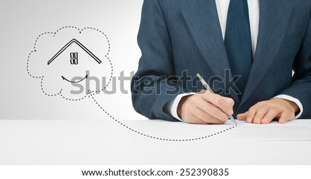 Sign mortgage, insurance, lease (tenancy) agreement or another house related document.  - stock photo