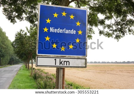 Sign near the border of The Netherlands written in German - stock photo