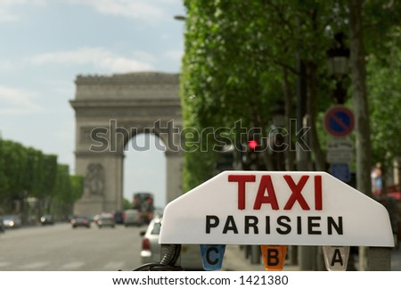 Sign of a parisian taxi on the Champs-Elysees. - stock photo