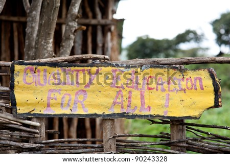Sign of a school in Ethiopia saying Quality Education For All - stock photo