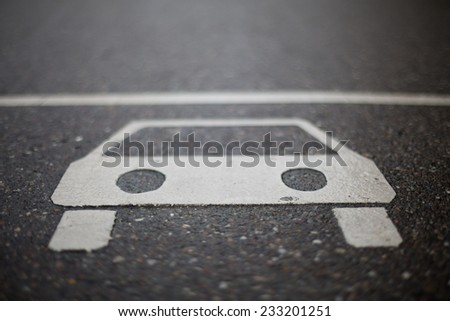sign of car on road  - stock photo