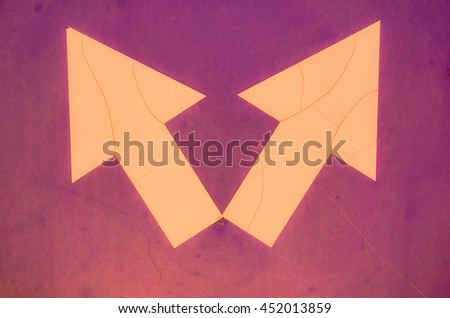 Sign of detour obstacles on the left or on the right with cracked pink and violet color paint texture. Two pink arrows - stock photo