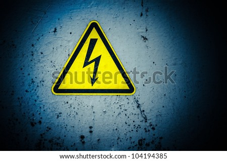 Sign of  High Voltage Danger on dark dirty background - stock photo