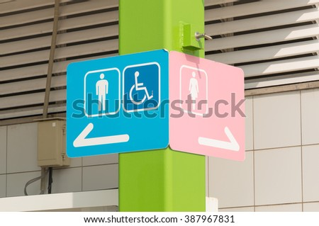 Sign of public toilets, men lady and  wheelchair pink - stock photo