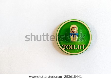 Sign of Public toilets WC restroom on concrete wall background - stock photo