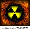 SIgn of radiation inside fire circle - stock photo