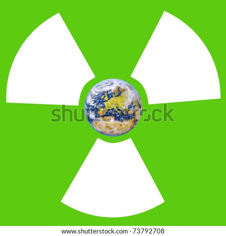 Sign of radiation with planet Earth in the center on green background - stock photo