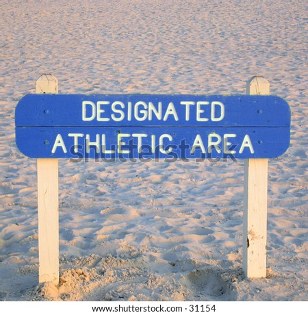 Sign on a beach designating the area as an athletic area