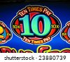 sign on a casino slot machine which is colorful and shows a big winner - stock photo