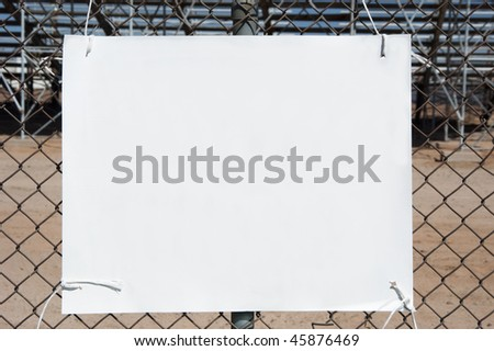 sign on a  chain link fence at an arena - stock photo