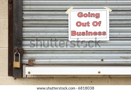 Sign on a closed steel door of a business that has gone bankrupt - stock photo