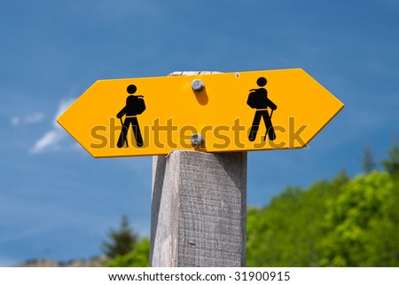 Sign on a mountain trail - stock photo