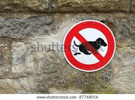 sign on a stone wall