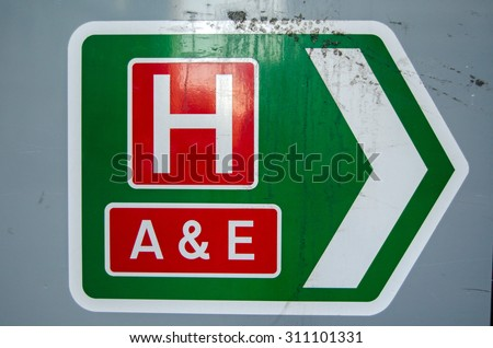 Sign on an A road showing the direction of the local hospital and the accident and emergency department. - stock photo