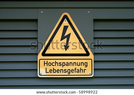 Sign on high electric voltage on a transformer box. - stock photo