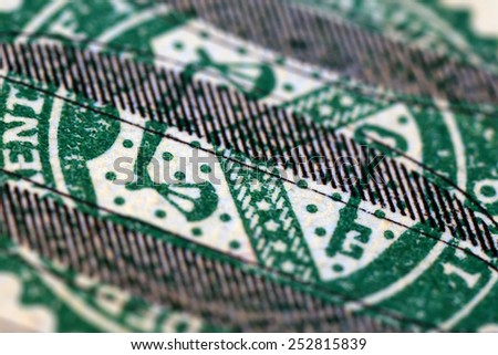 Sign on hundred dollar banknote, macro view - stock photo