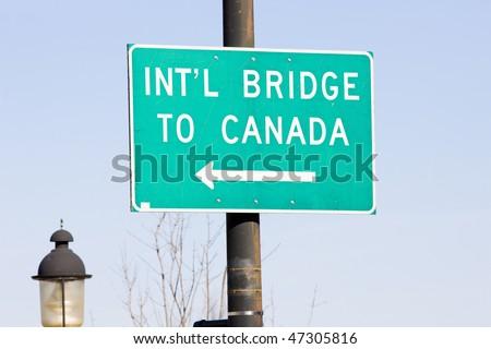 sign on the Canadian border, Calais, Maine, USA - stock photo
