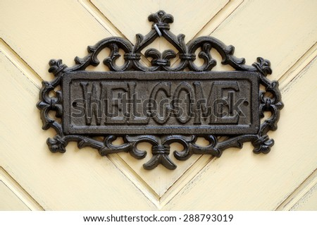 "Sign on the door ""welcome"" - stock photo"