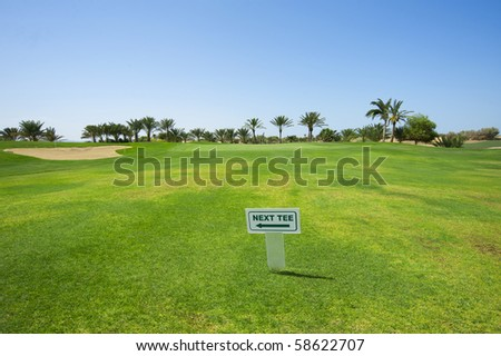 Sign on the fairway of a golf course indicating way to next hole - stock photo