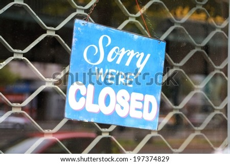 Sign on the front door of a shop - stock photo